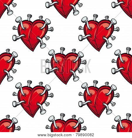 Seamless pattern with hearts and hammered nails