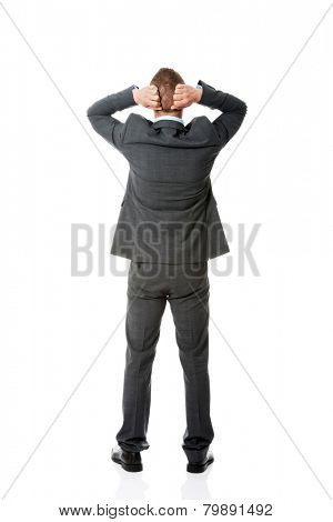 Full length businessman putting hands on the nape.