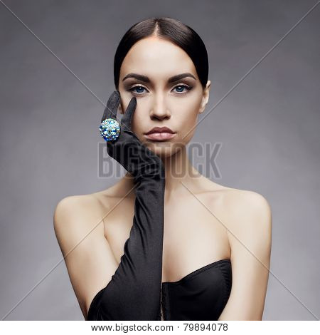 Fashion photo of beautiful lady in gloves with diamond ring