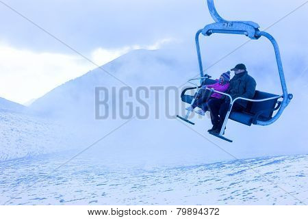 Unidentified Skiers Going Up With A Ski Lift And Enjoying The Last Ski Ride Of The Season In The Fal