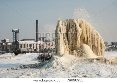 Winter geyser on sludge fields