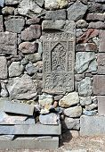 picture of tombstone  - Ancient armenian tombstone in the monastery stone wall - JPG