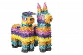 foto of pinata  - Two colorful Mexican pinatas isolated on a white background - JPG