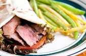 image of flank steak  - flank steak burrito on home made flatbread with garlic fried string beans - JPG