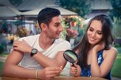 picture of propose  - Young couple getting engaged in funny wedding proposal scene - JPG