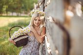 stock photo of chamomile  - Village woman - JPG