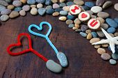 stock photo of love hurts  - Colourful harmony Valentine background amazing style heart on pebble I love you message on stone wooden red color Valentine day on Feb 14 is the day for couple they give lovely gift for lover - JPG