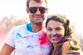 pic of holi  - Portrait of happy couple in love on holi color festival - JPG