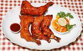 spicy and tasty tandoori chicken legs poster