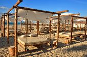 stock photo of suny  - blue sky and sand suny beach with suspended beds - JPG