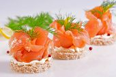 stock photo of sandwich  - Sandwich with smoked salmon on white background - JPG