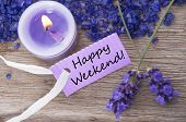 picture of purple white  - Purple Label With Candle Light And Lavender Blossoms With English Text Be Happy Weekend On Wooden Background With White Ribbon Top View - JPG
