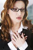 image of breast-stroke  - Young businesswoman having heart disease - JPG