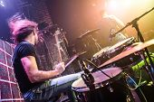 picture of drums  - Drummer playing on drum set on stage - JPG
