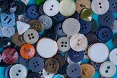 image of orifice  - the background of a large number of buttons closeup - JPG