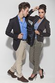 picture of elbows  - Full length picture of a casual couple posing together on studio background - JPG