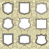 image of damask  - Set of shield frames on seamless damask background - JPG