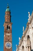 foto of vicenza  - Bottom perspective of the famous Clock Tower of Vicenza with the Palladian Basilica and its typical statues - JPG