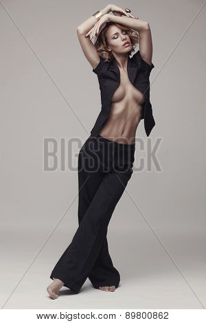 Fashion photo of sexy woman in black suit