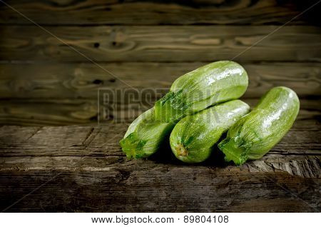 Ripe Zucchini And Marrow Vegetables Isolated On Wooden Background