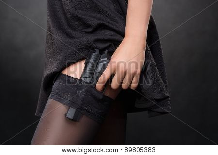 girl hand with a gun