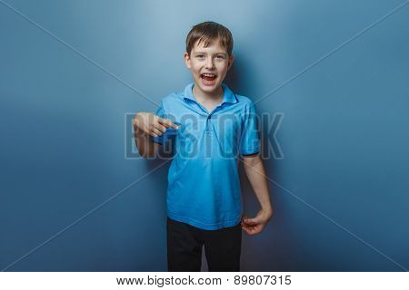 Boy teenager European appearance decade fingers pointing down on