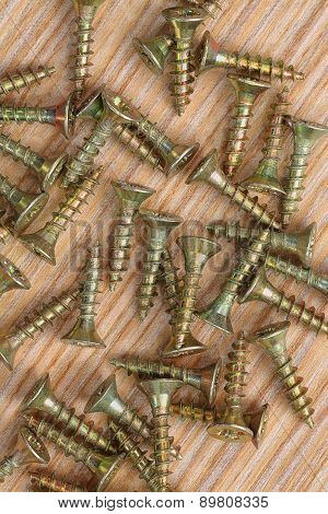 Screws On A Wooden Background Close Up