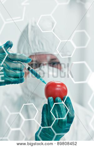 Science and medical graphic against researcher in protective suit injecting tomato at lab