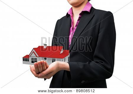 Businesswomans holding hands out against 3d house