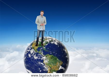 Suave man in a blazer against blue sky over clouds