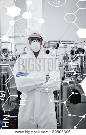 Science formula against scientist in protective suit standing with arms crossed