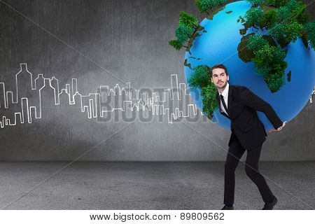 Businessman carrying the world against hand drawn city plan
