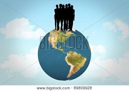 Silhouette of team of people against blue sky