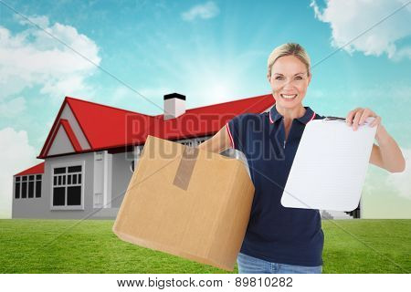 Happy delivery woman holding cardboard box and clipboard against blue sky