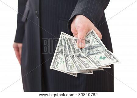 Businesswoman holding dollars close-up