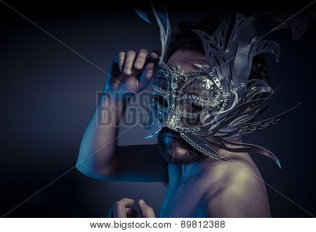 Costume, bearded man with silver mask Venetian style. Mystery and renaissance