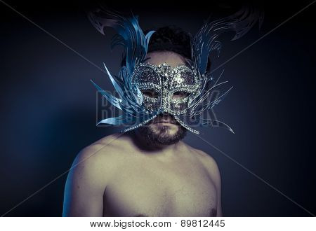 Party, bearded man with silver mask Venetian style. Mystery and renaissance