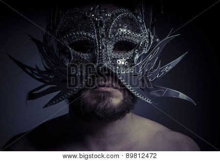 bearded man with silver mask Venetian style. Mystery and renaissance