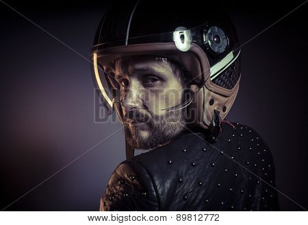 Motorbike, biker with motorcycle helmet and black leather jacket, metal studs