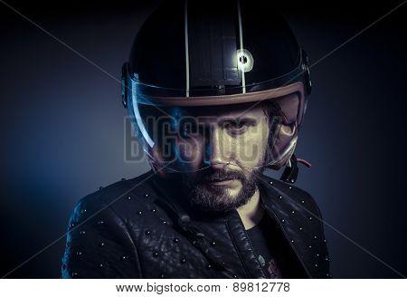 Energy, biker with motorcycle helmet and black leather jacket, metal studs