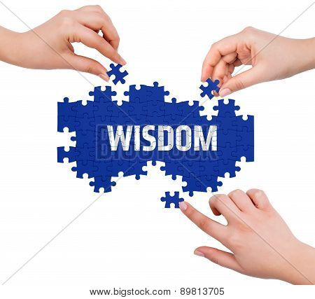 Hands With Puzzle Making Wisdom Word  Isolated On White