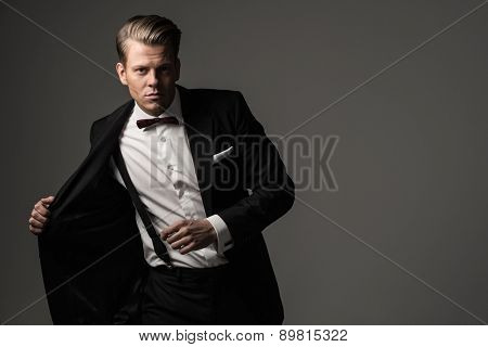 Sharp dressed man wearing jacket and bow tie