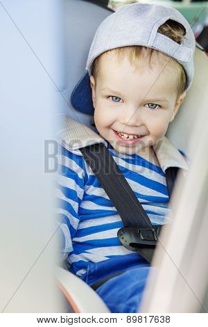 Portrait Happy Toddler Boy Sitting In The Car