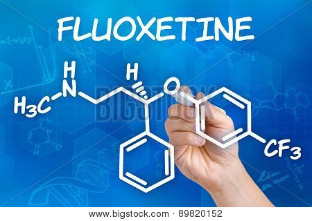 Hand With Pen Drawing The Chemical Formula Of Fluoxetine