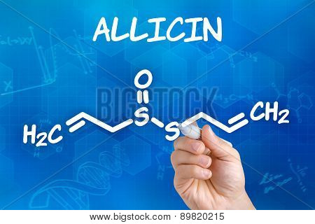 Hand With Pen Drawing The Chemical Formula Of Allicin