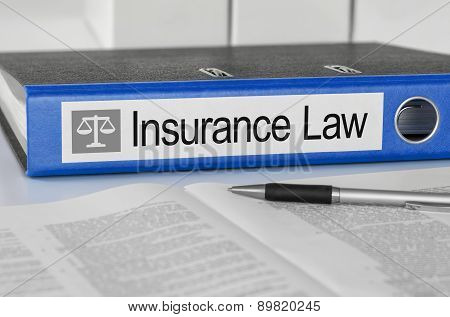 Blue Folder With The Label Insurance Law