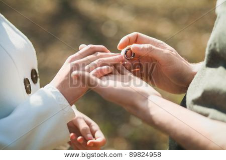 Wedding Rings. Hands Of Bride And Groom
