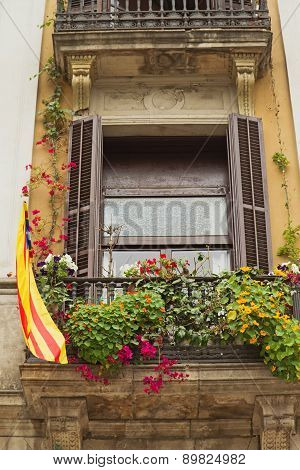 Window With A Catalan Flag.