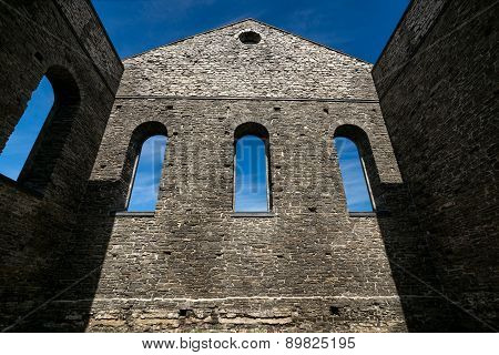 Stone Wall Of Ancient Church Ruins With Gothic Windows