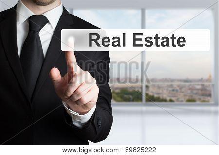 Businessman Pushing Button Real Estate